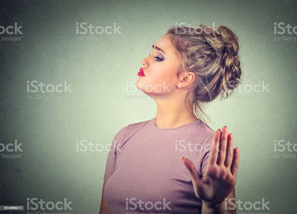 Snobby annoyed woman giving talk to hand gesture stock photo