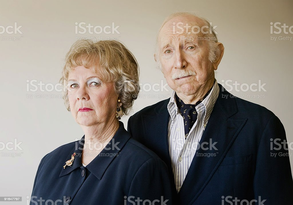 Snooty Senior Couple with Strong Woman royalty-free stock photo