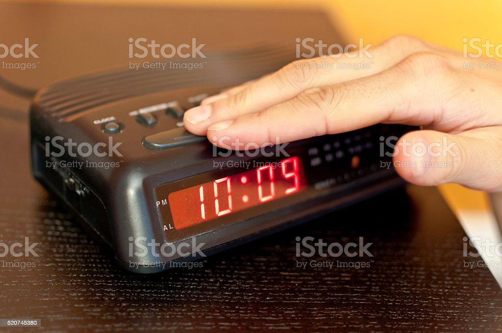 Snoozing the morning alarm stock photo