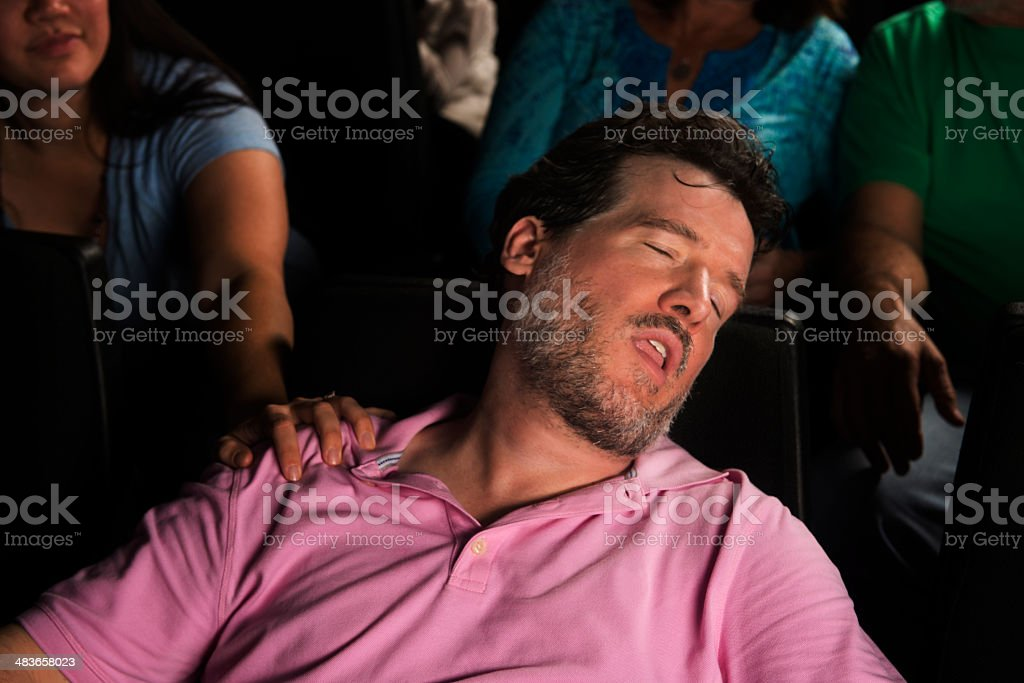 Snoring Man Disturbs Others at the Movies stock photo