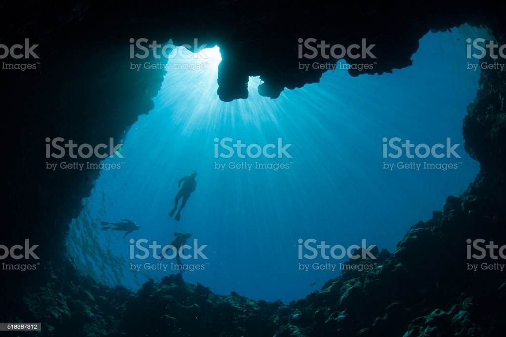 Snorkelers and Blue Hole stock photo