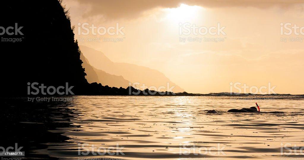 Snorkeling at sunset in Kauai - Panorama stock photo