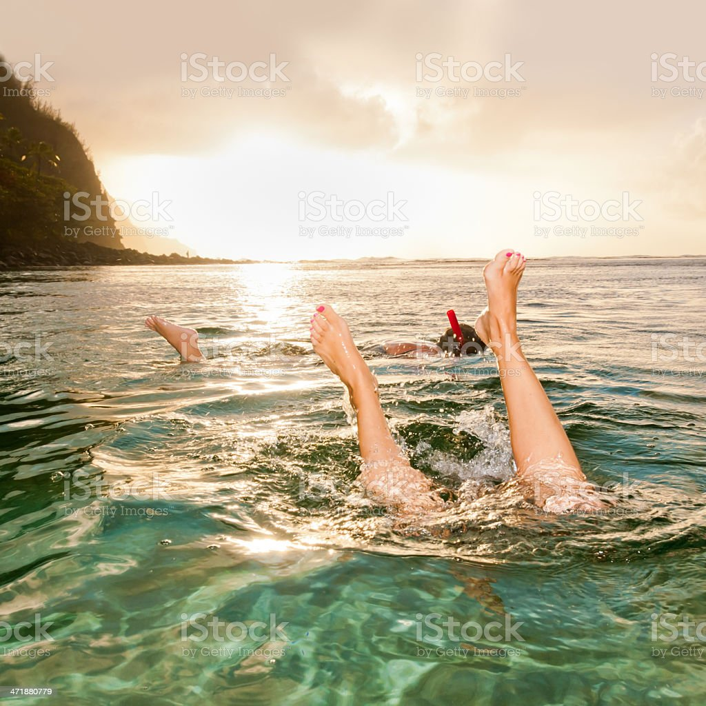 Snorkeling at sunset in Kauai stock photo