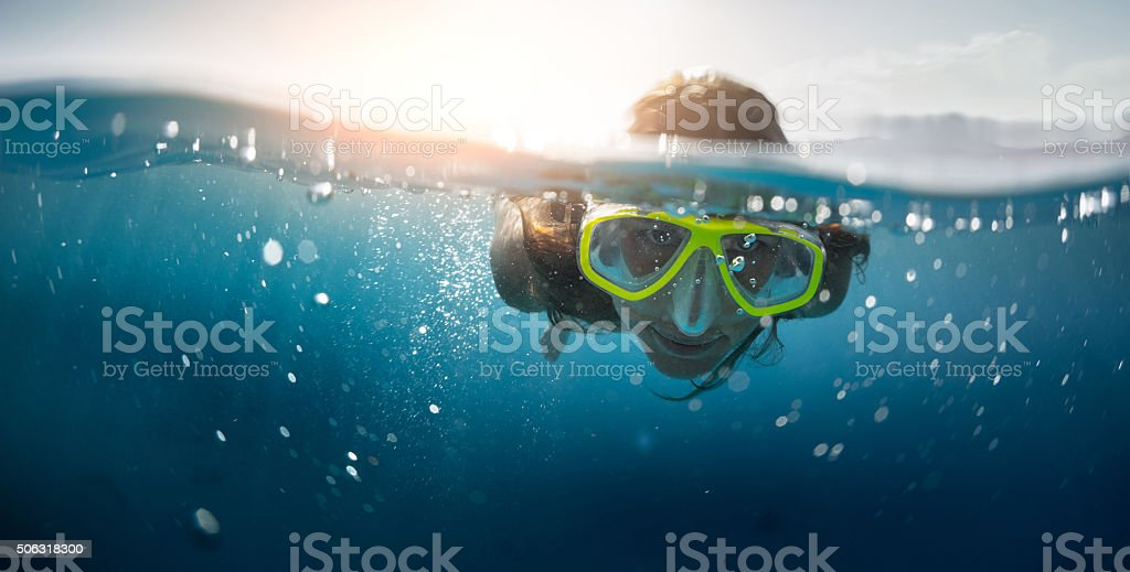 Snorkeling in the sea stock photo