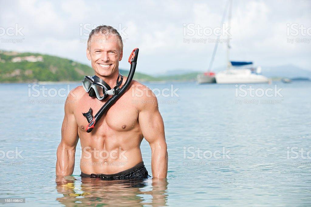 Snorkeling Man on Sailboat Vacation royalty-free stock photo