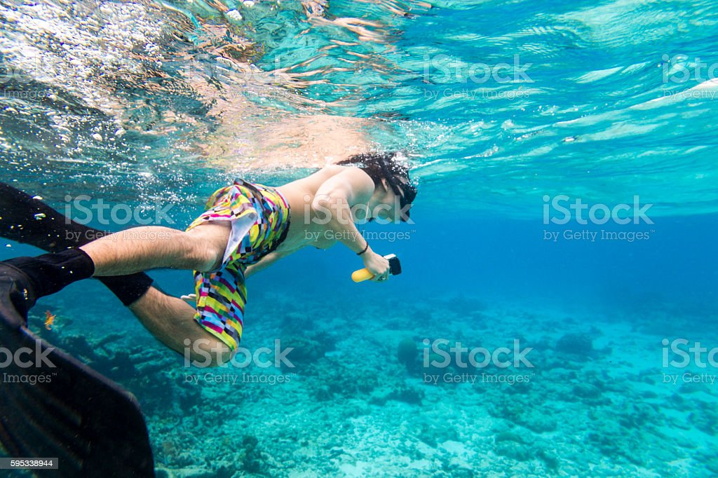 Snorkeling with underwater camera stock photo