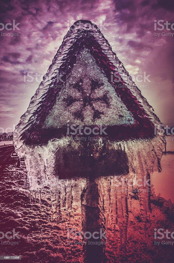 snow alert frozen sign on road stock photo