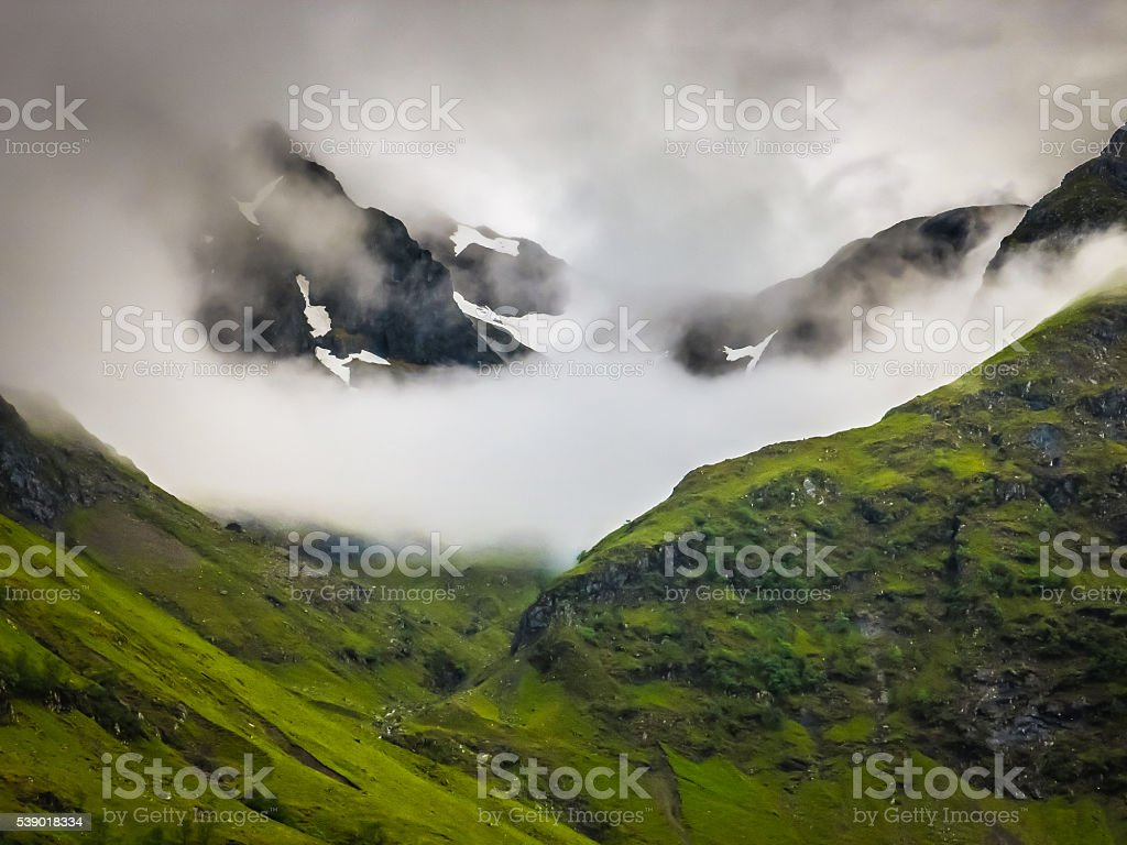 Snow and Fog in the Mountains of Glencoe, Scotland stock photo