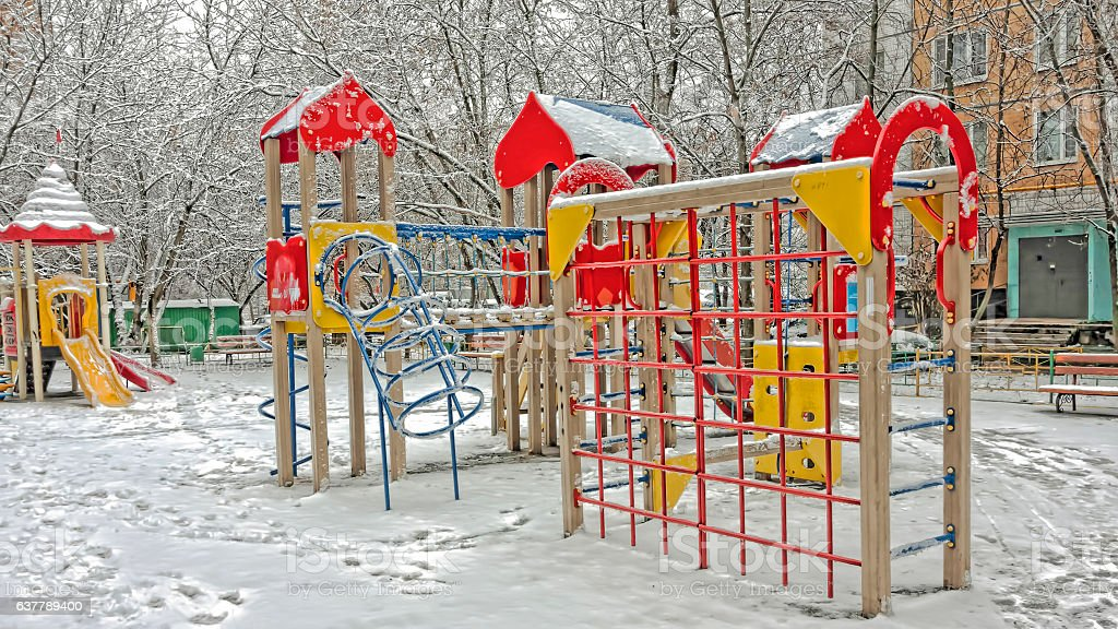 Snow and frost in the playground stock photo