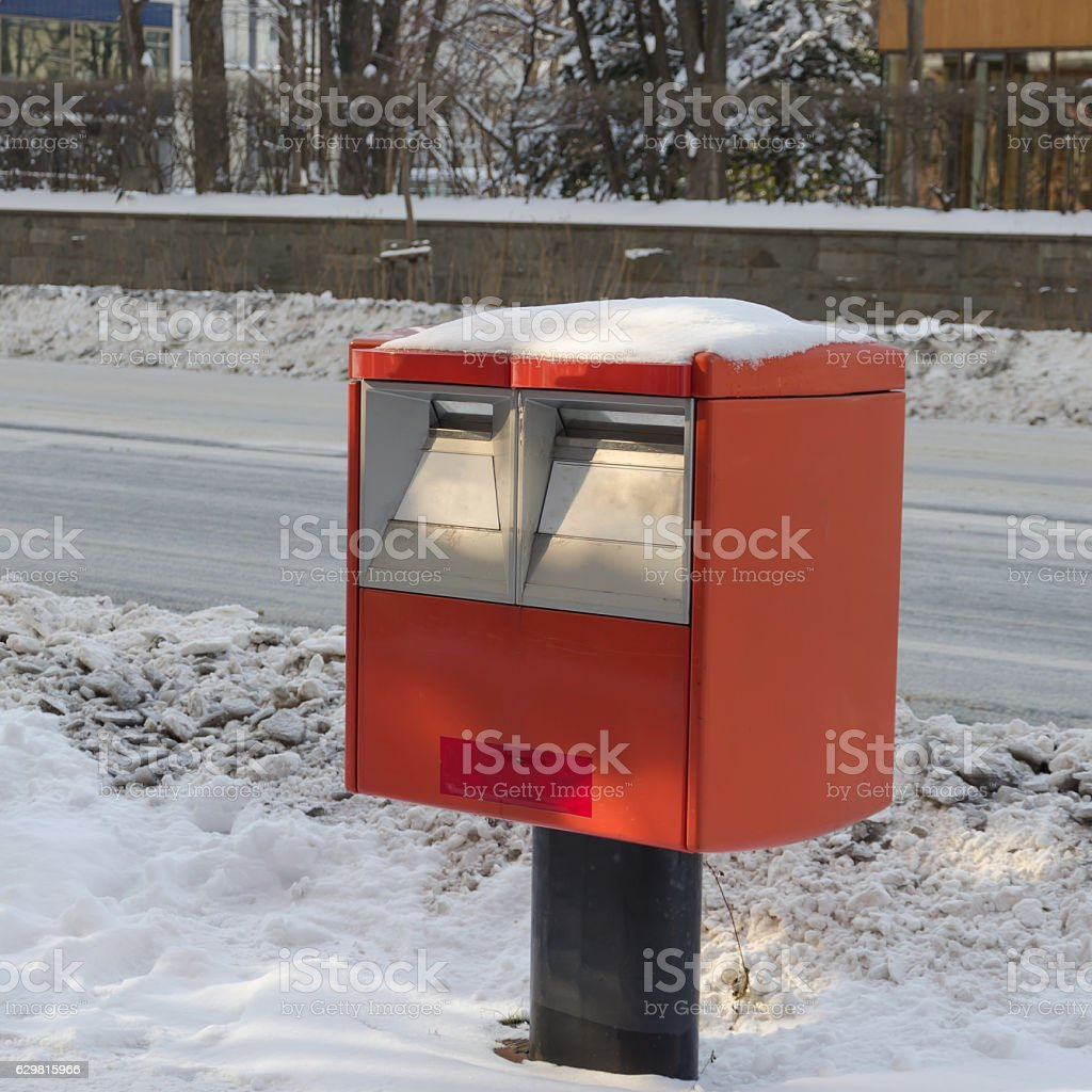 Snow and Red mailbox of Japan Post Service stock photo
