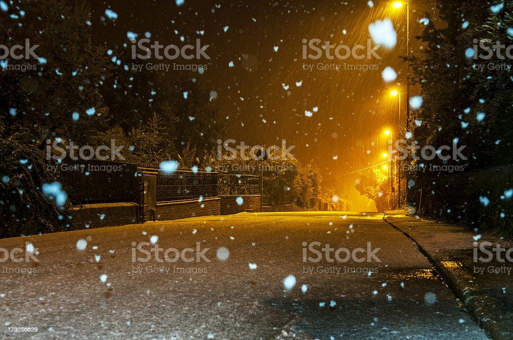 Snow at night on the street stock photo