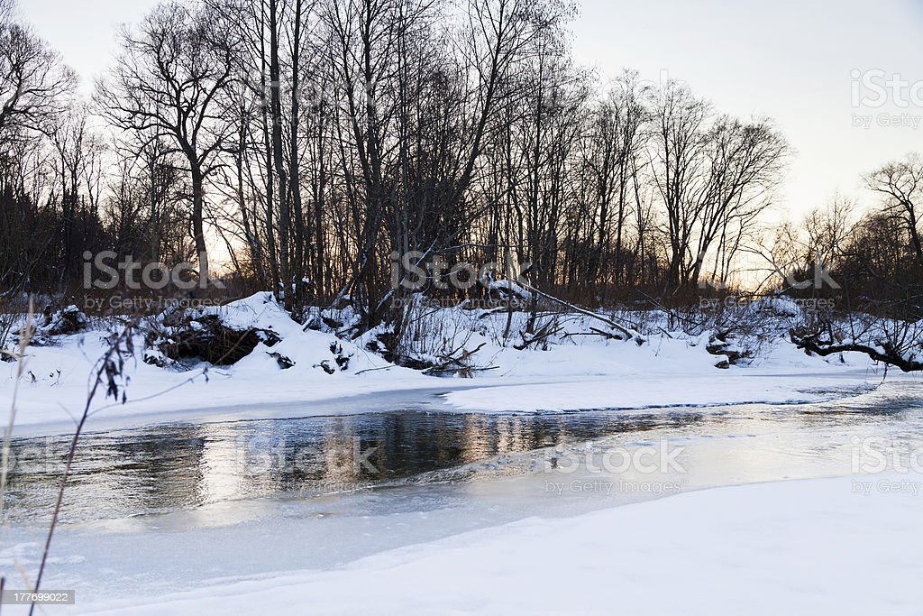 snow banks of forest river royalty-free stock photo