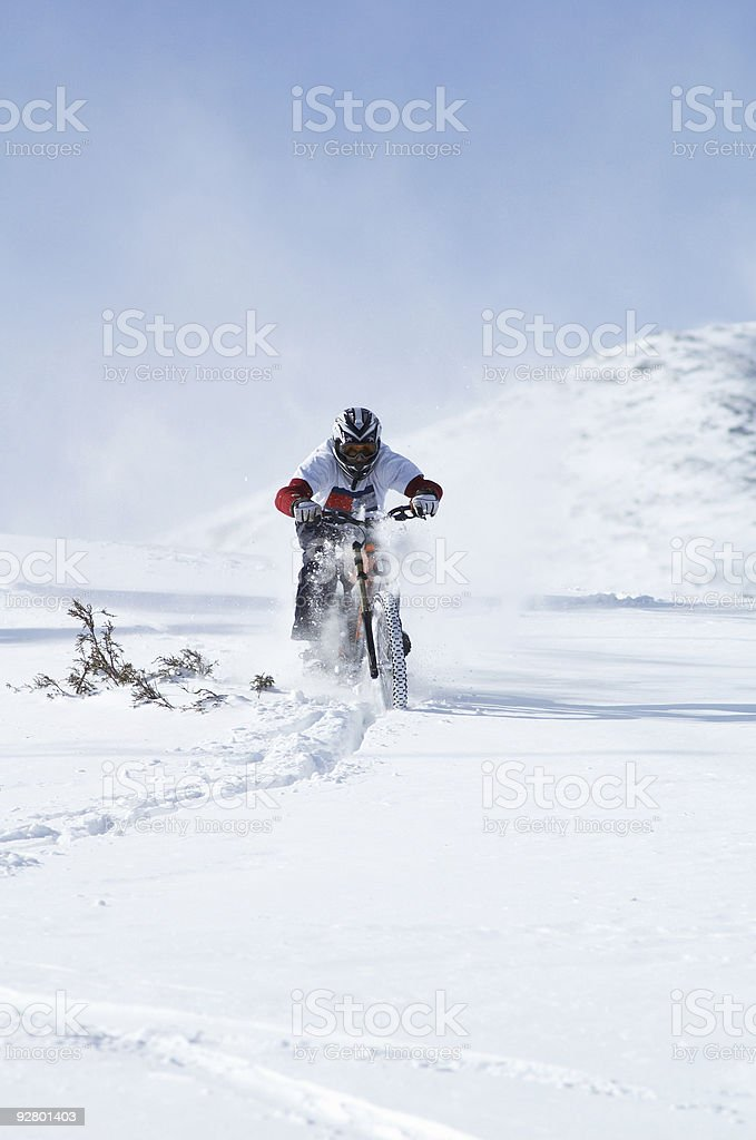 Snow biker downhill royalty-free stock photo