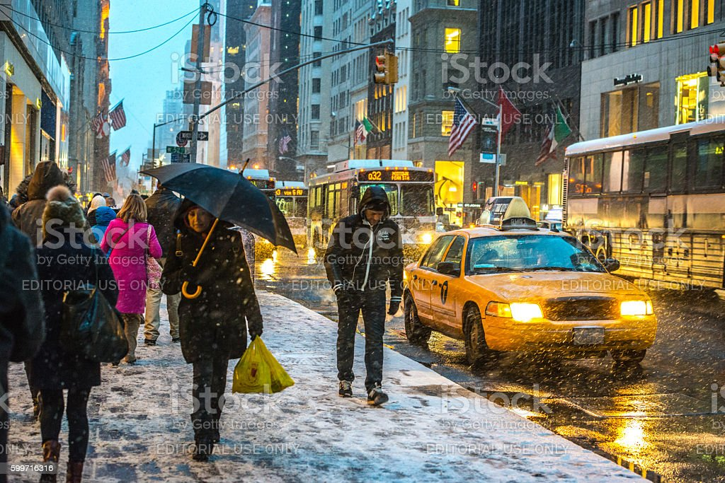 Snow blizzard, Traffic and people on 5th Avenue, NYC stock photo