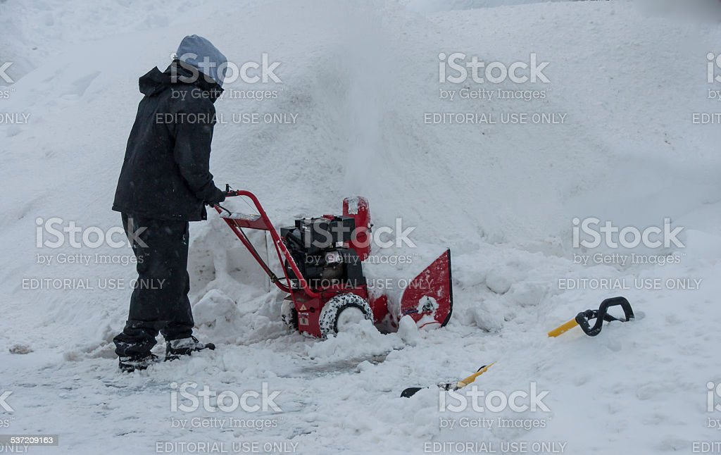 Snow Blowing A Driveway stock photo