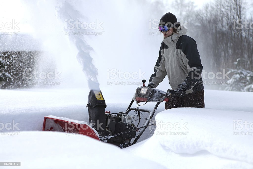 snow blowing man stock photo