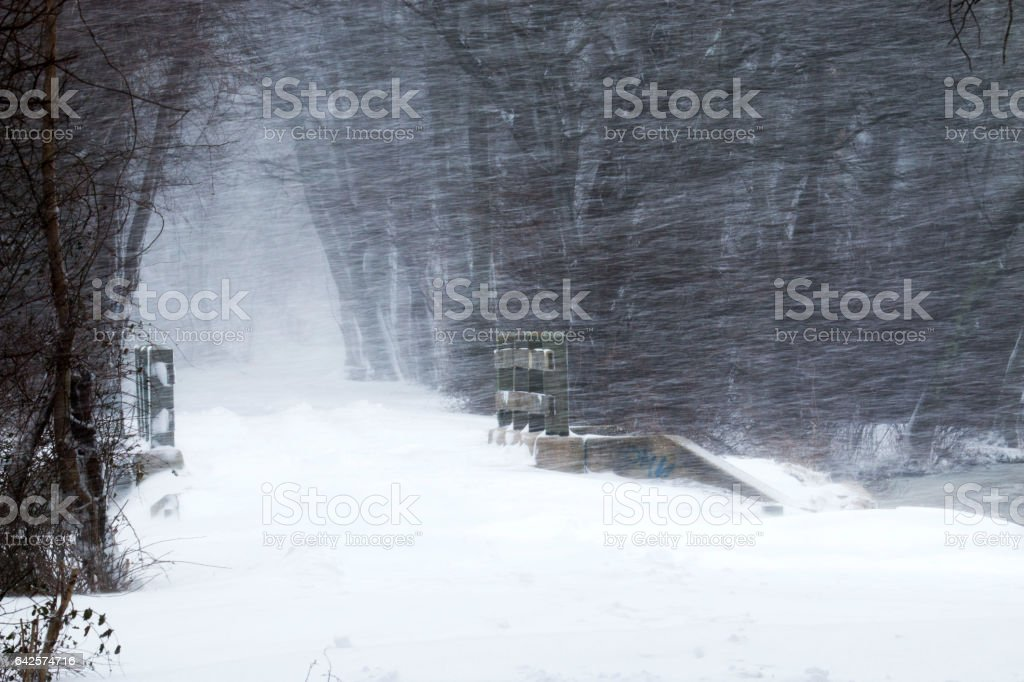 Snow blowing sideways during a storm stock photo