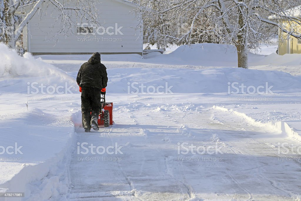 Snow Blowing the driveway stock photo