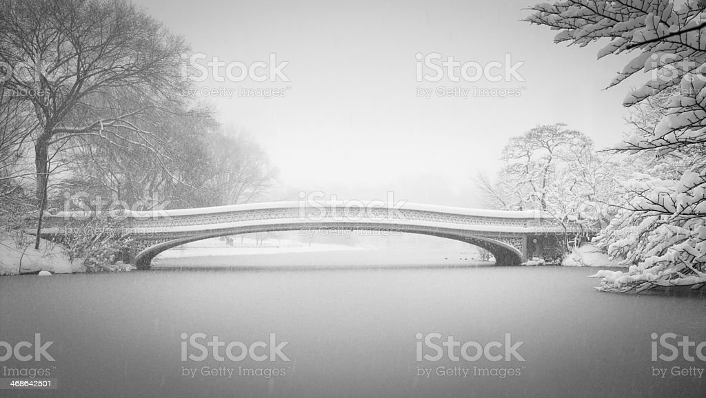 Snow Bow Bridge and the Lake Central Park New York stock photo