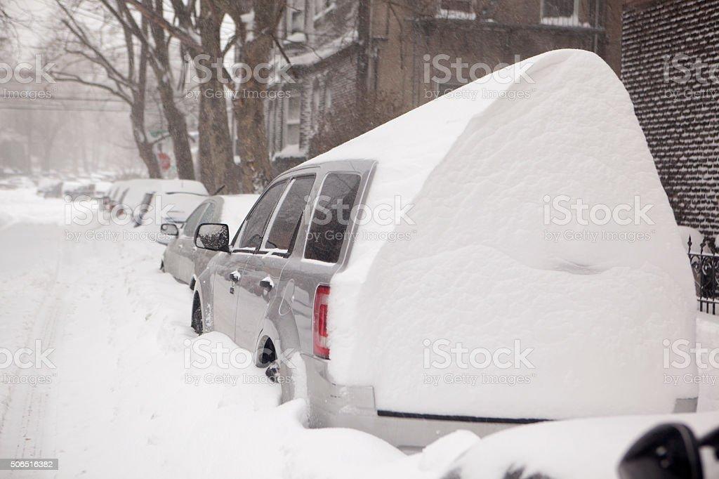 snow buried cars stock photo