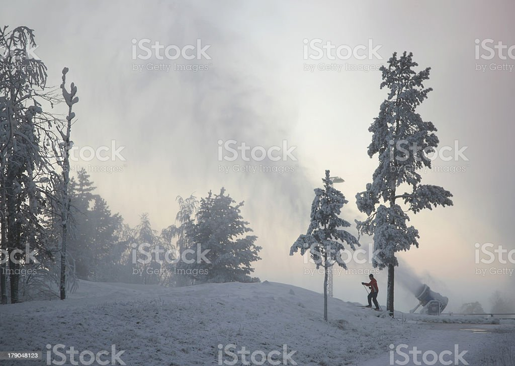 Snow Cannon and a Cross Country Skier royalty-free stock photo