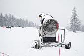 snow cannon being used to cover a mountain