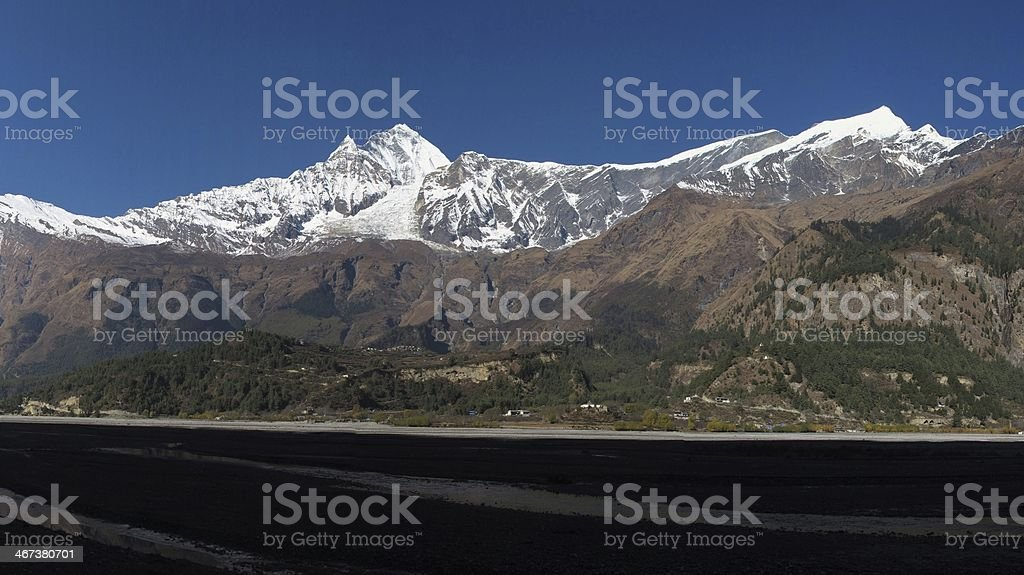 Snow capped Dhaulagiri and Tukuche Peak royalty-free stock photo