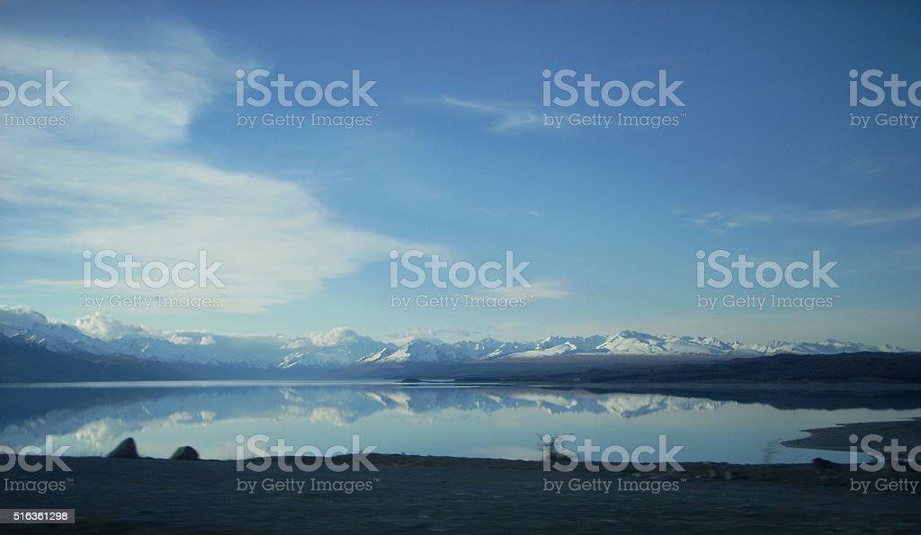 Snow Capped Mountains Reflected in Lake Pukaki stock photo