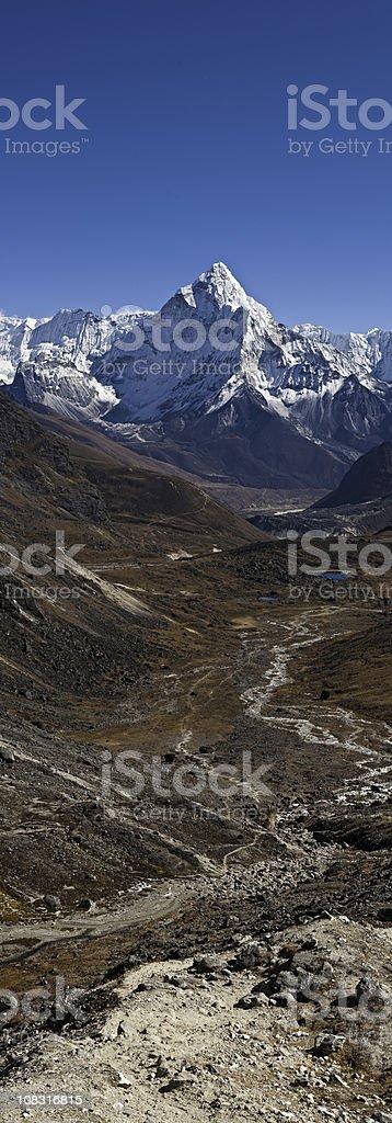Snow capped summit mountain trail Ama Dablam Himalaya vertical Nepal royalty-free stock photo