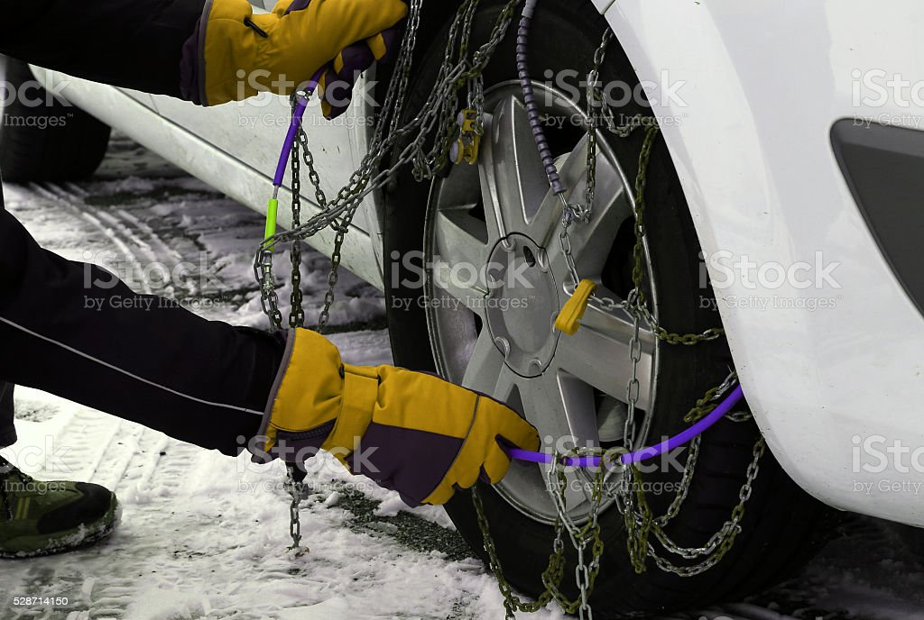 snow chains in the car tyre in winter on snow stock photo