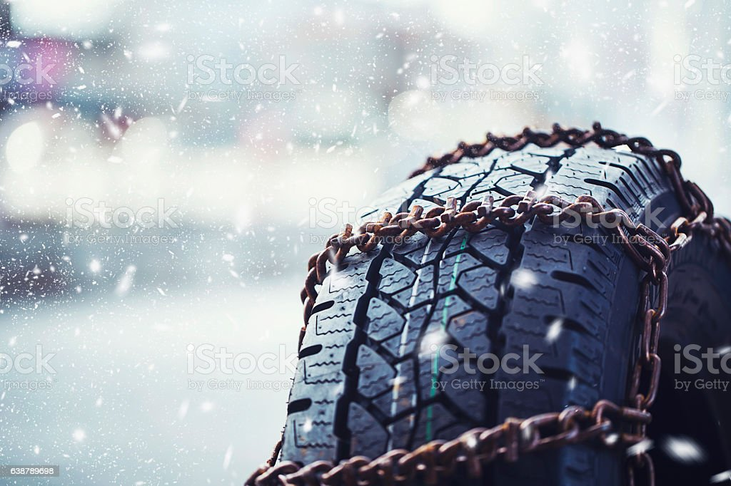 Snow chains on tire stock photo