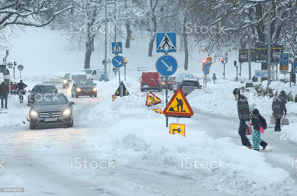 Snow chaos in the traffic, people struggling in snow stock photo