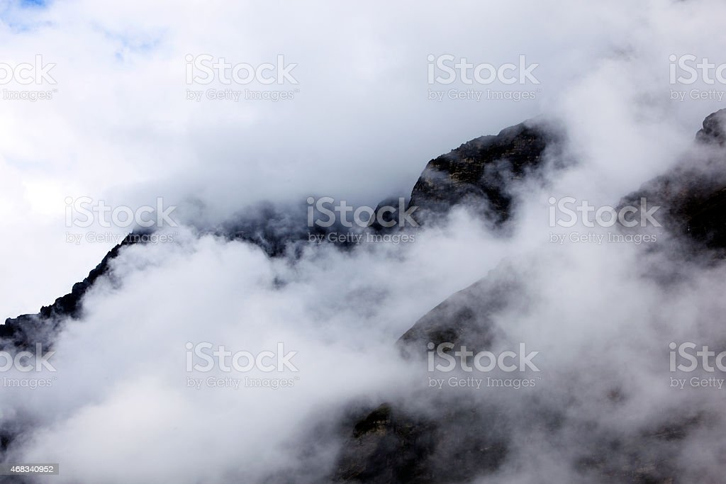 Snow clad mountain in fog- himalayan mountain range , Sikkim, India stock photo
