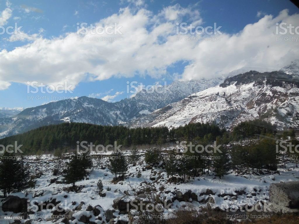 Snow clad mountain nature scenery stock photo