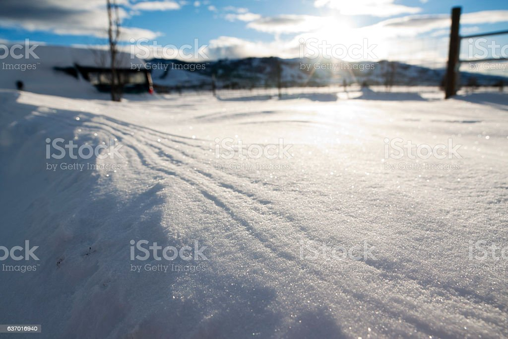 Snow Close-up with Fence and Mountains stock photo