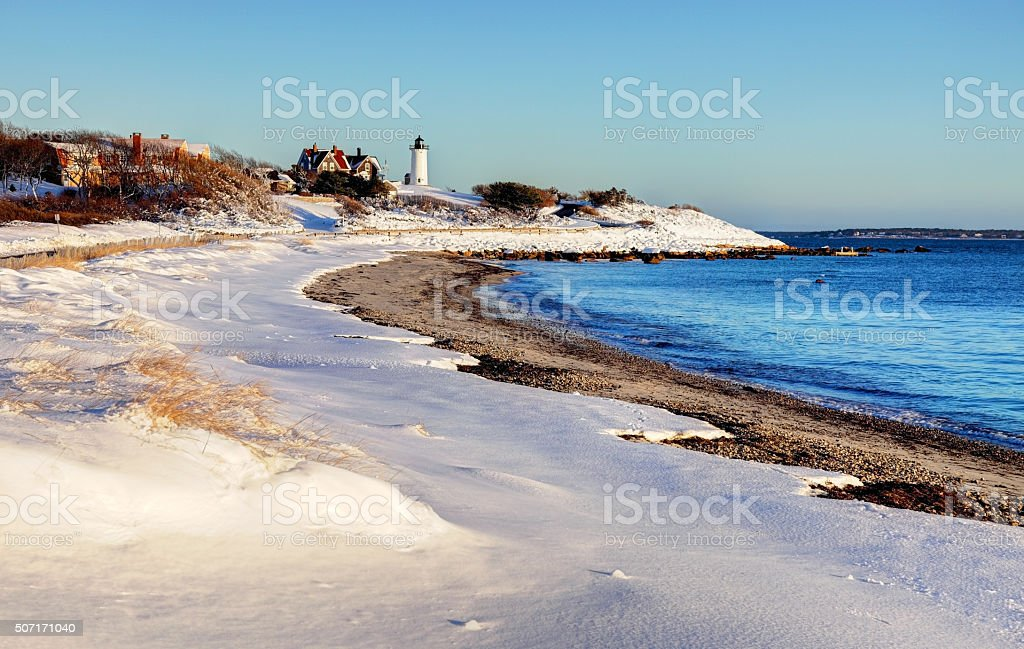Snow Coverd Dunes and the Nobska Lighthouse on Cape Cod stock photo