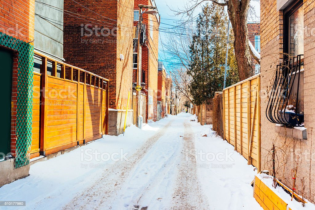 Snow Covered Alley Street with Architecture in Plateau Mont-Royal Montreal stock photo
