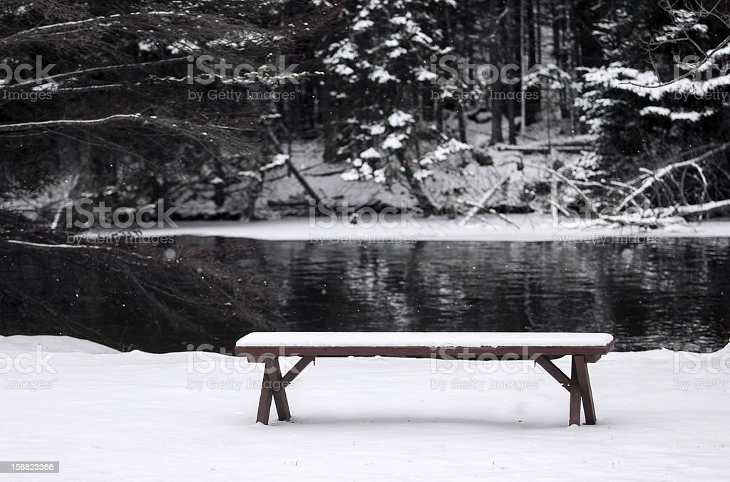 Snow covered bench stock photo