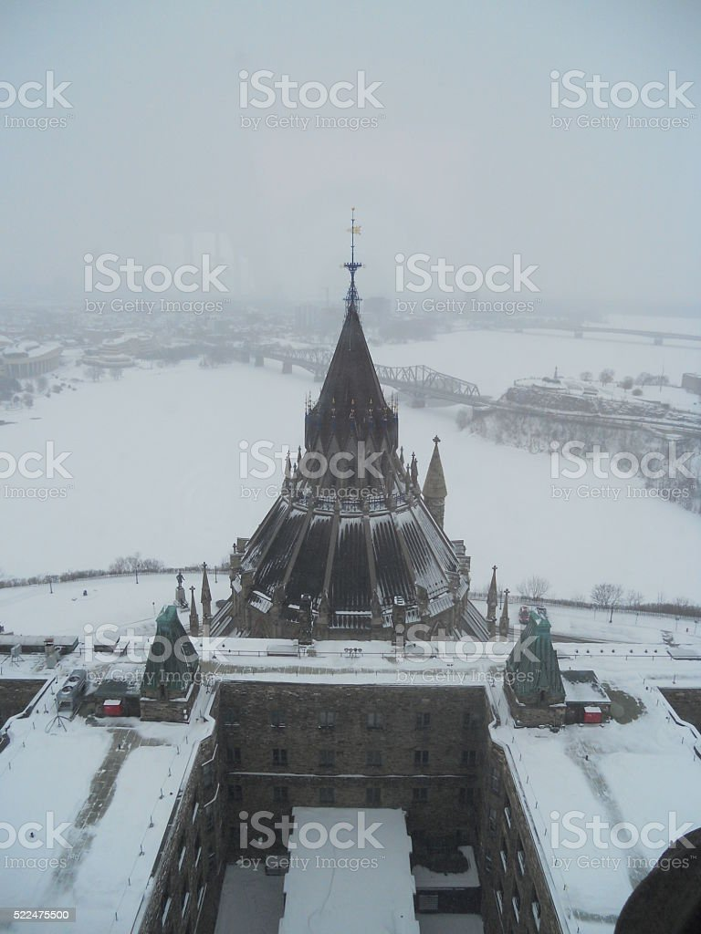 Snow Covered Building Beside Frozen River stock photo