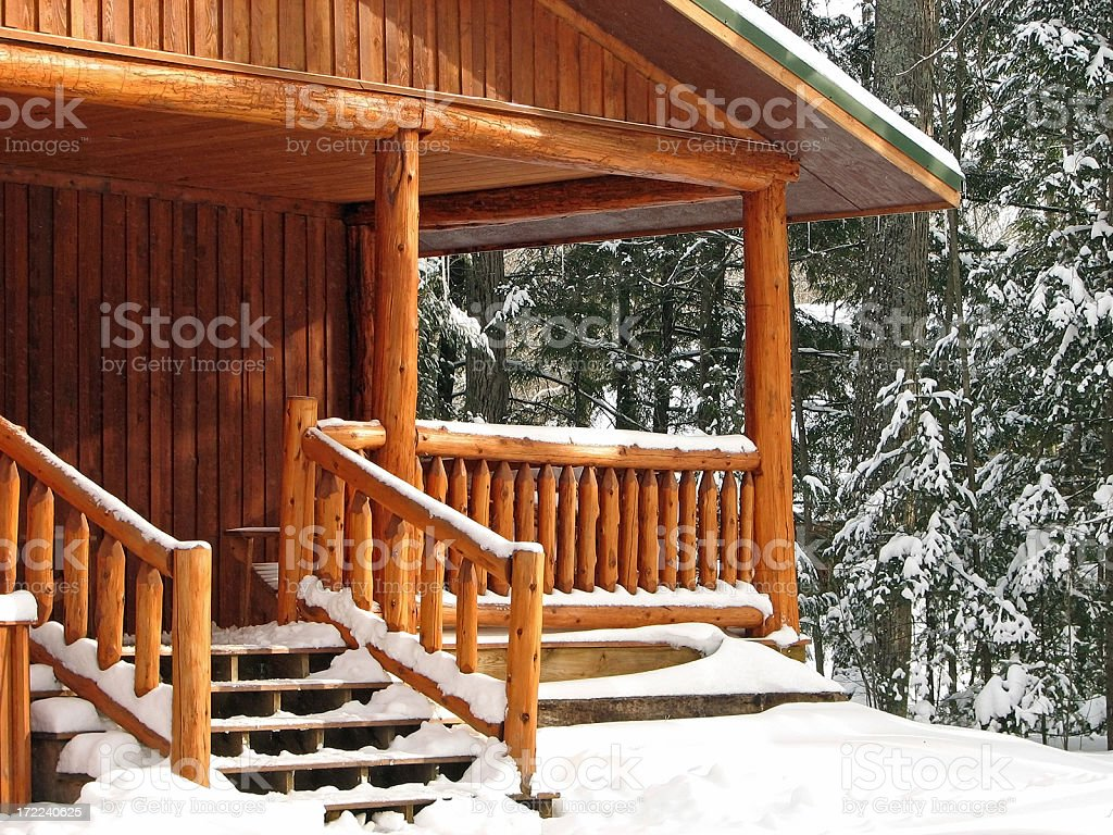 Snow Covered Cabin Porch stock photo
