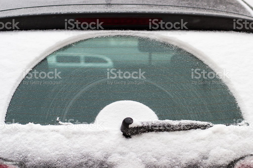 snow covered car glass stock photo