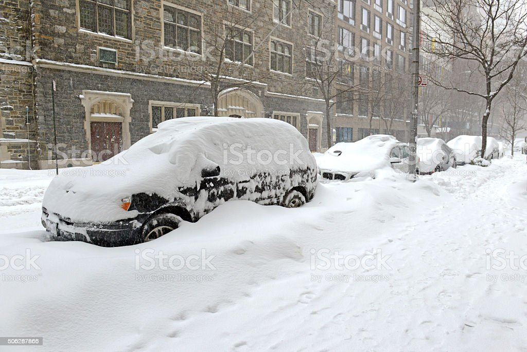 Snow covered car in Blizzard in Manhattan, New York City stock photo