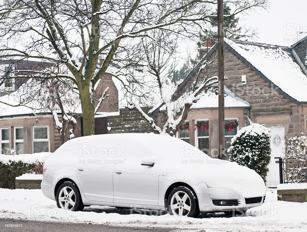 Snow Covered Car on the Street stock photo