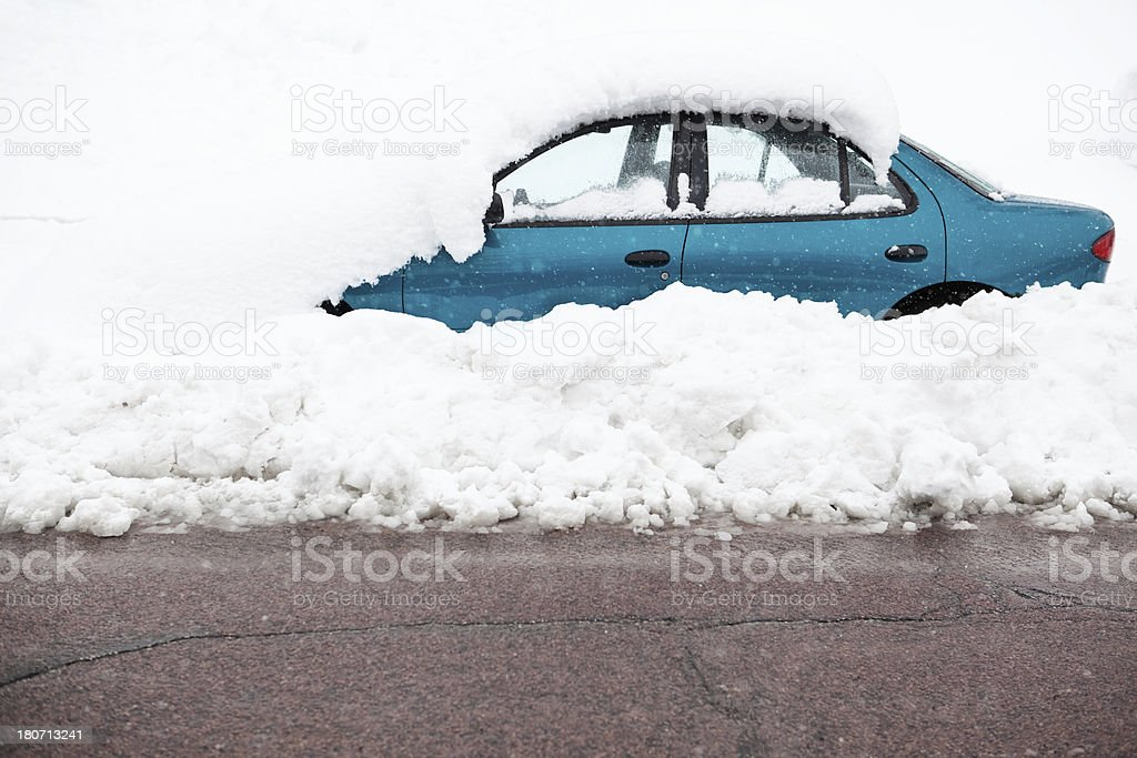 Snow Covered Car Parked on Plowed Street royalty-free stock photo