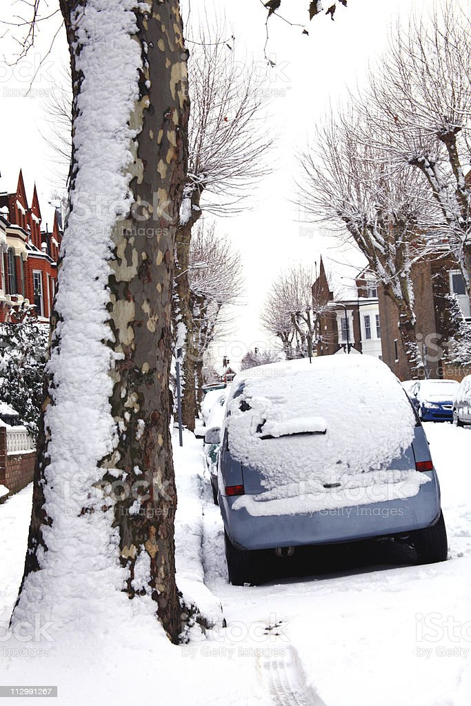 Snow Covered Cars In A Terraced Street royalty-free stock photo