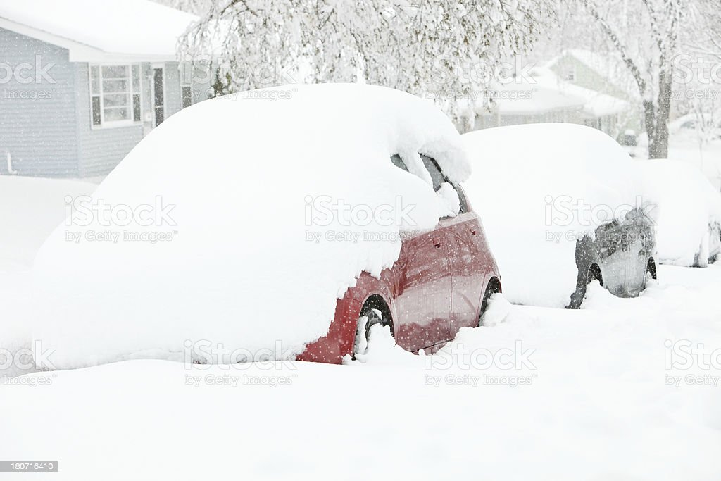 Snow Covered Cars Parked on Street near Homes royalty-free stock photo