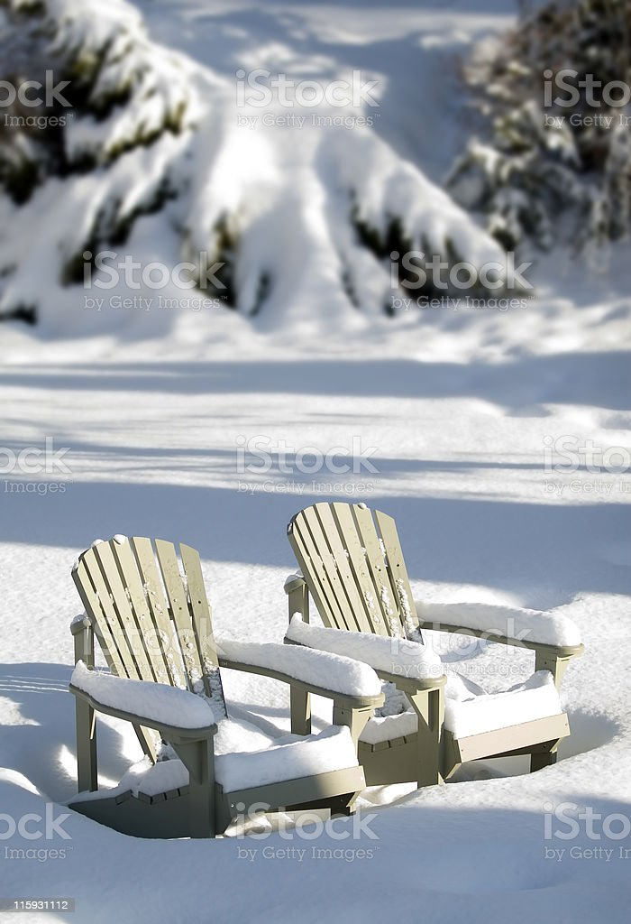 snow covered chairs stock photo