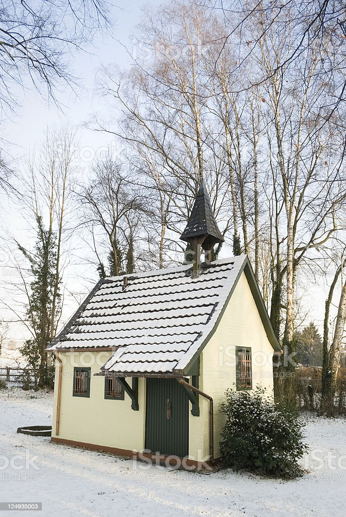 Snow covered chapel in winter stock photo