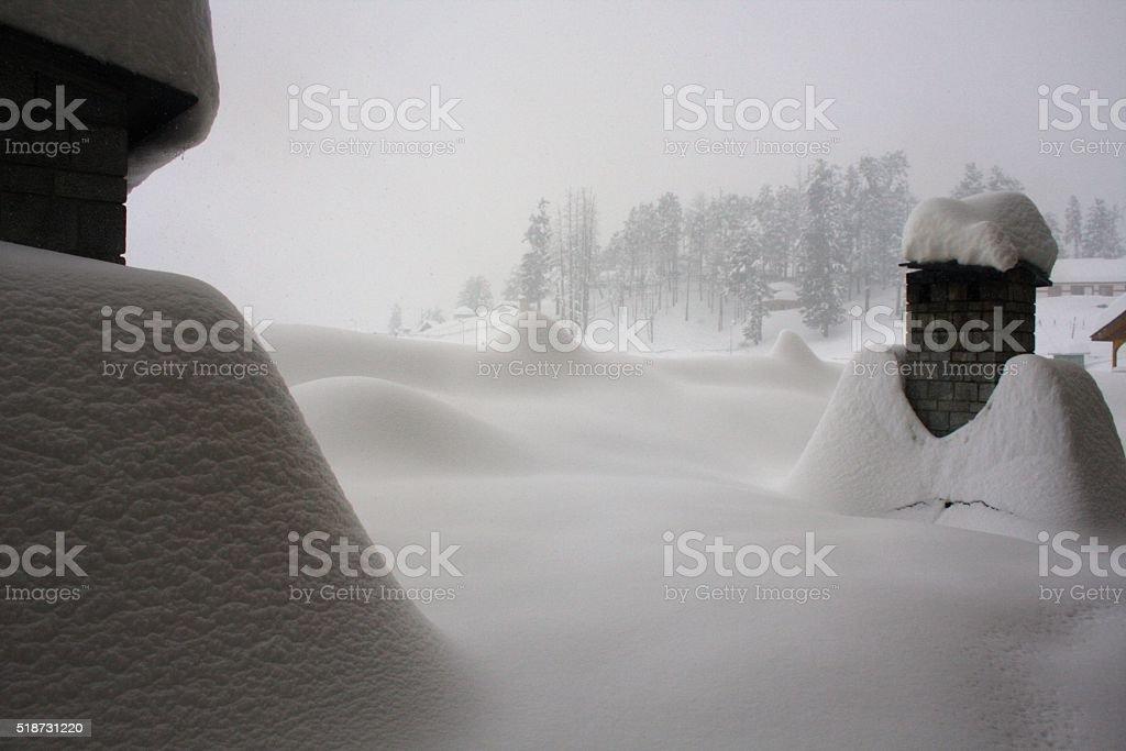 Snow Covered Chimneys stock photo