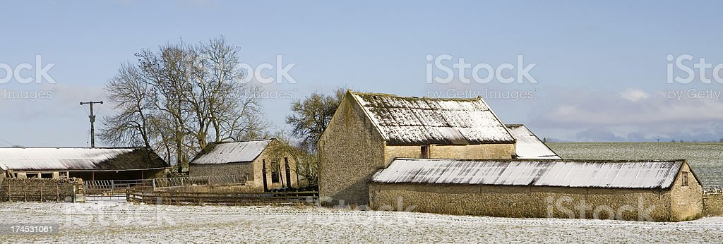 Snow covered Cotswold barn in Oxfordshire stock photo